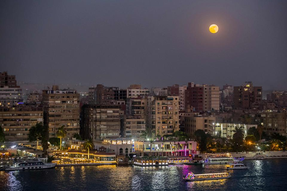 The full Strawberry moon, the last super moon of the year, rises above the Egyptian capital Cairo, on June 24, 2021.