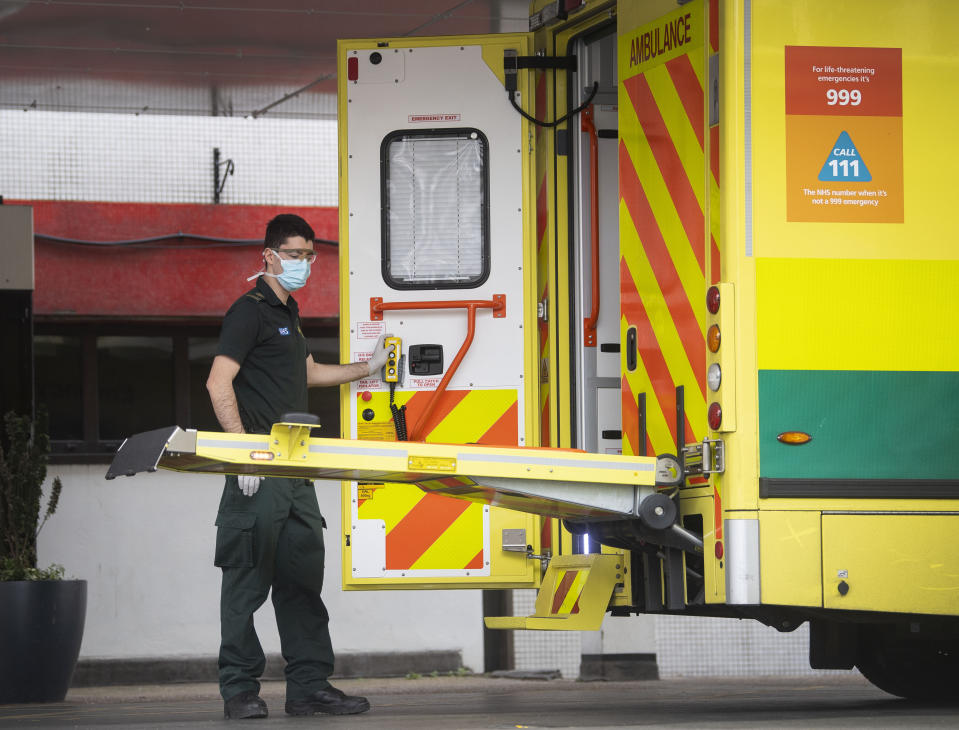 A paramedic escorts a patient arriving at St Thomas' Hospital in Westminster, London as the UK continues in lockdown to help curb the spread of the coronavirus.