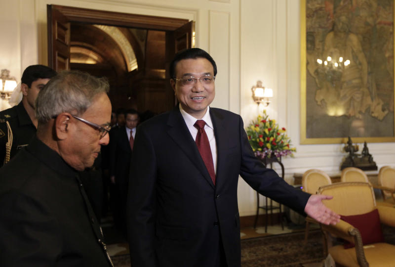 Chinese Premier Li Keqiang, right, arrives for a meeting with Indian President Pranab Mukherjee, left, at the Indian Presidential Palace in New Delhi, India, Tuesday, May 21, 2013. Keqiang is on a three-day visit to discuss bilateral and trade ties. (AP Photo /Manish Swarup)