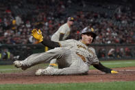 San Diego Padres' Manny Machado slides home to score against the San Francisco Giants during the second inning of a baseball game in San Francisco, Wednesday, Sept. 15, 2021. (AP Photo/Jeff Chiu)