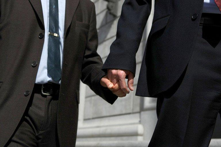 Same-sex couple hold hands in San Francisco, California on May 15, 2008