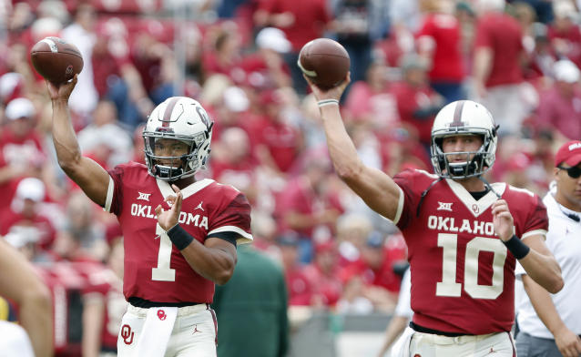 Oklahoma quarterback Kyler Murray (1) and quarterback Austin Kendall (10) warm up before the start of an NCAA college football game against Baylor in Norman, Okla., Saturday, Sept. 29, 2018. (AP Photo/Alonzo Adams)