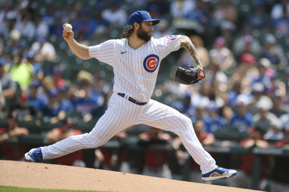Chicago Cubs starter Trevor Williams delivers a pitch during the first inning of a baseball game against the Arizona Diamondbacks, Sunday, July 25, 2021, in Chicago. (AP Photo/Paul Beaty)