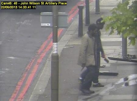 Michael Adebowale (L) and Michael Adebolajo walk back to the south footpath of Artillery Place in Woolwich in this handout still image taken from May 22, 2013 CCTV footage by the Metropolitan Police, that was shown to the jury during the Lee Rigby murder trial at the Old Bailey in London December 3, 2013. REUTERS/Metropolitan Police/Handout via Reuters