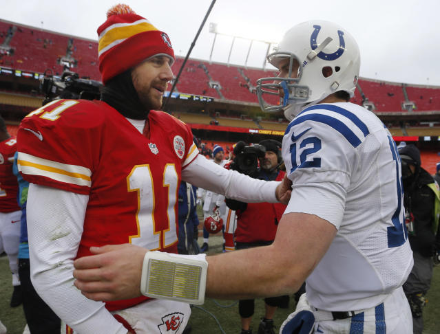 Kansas City Chiefs quarterback Alex Smith (11) and Indianapolis Colts quarterback Andrew Luck (12) talk following an NFL football game at Arrowhead Stadium in Kansas City, Mo., Sunday, Dec. 22, 2013. The Colts defeated the Chiefs 23-7. (AP Photo/Ed Zurga)