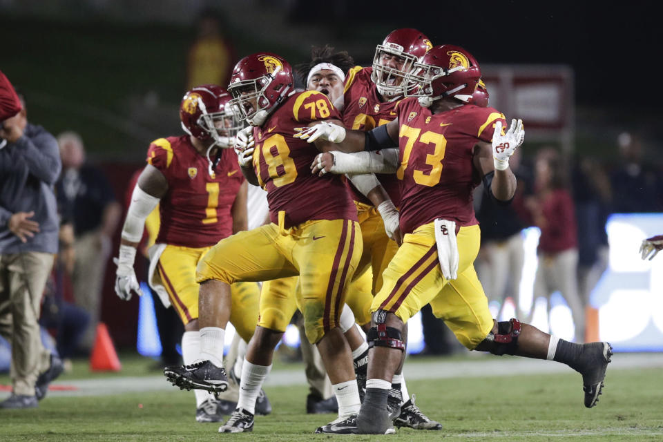 Southern California defensive lineman Jay Tufele (78) and teammates celebrate after Tufele blocked a kick by Washington State punter Blake Mazza during the second half of an NCAA college football game, Friday, Sept. 21, 2018, in Los Angeles. (AP Photo/Jae C. Hong)