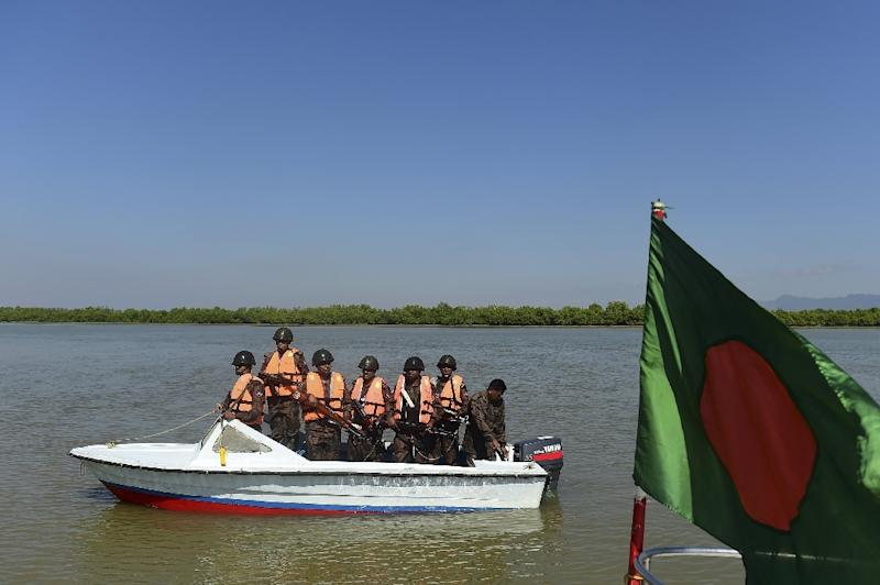 Bangladesh border personnel patrol the Naf river to stop the illegal entry of Myanmar Rohingya refugees as they attempt to flee Myanmar