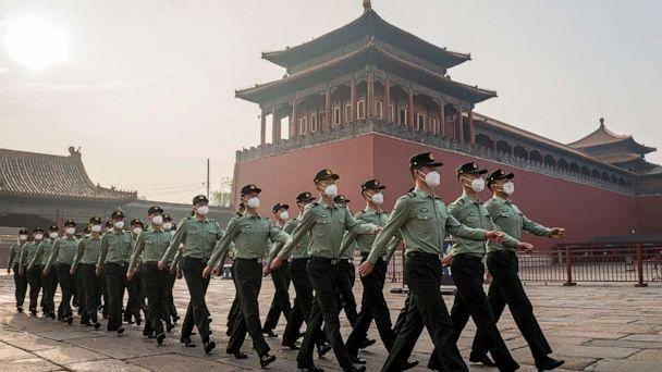 PHOTO: People's Liberation Army soldiers march next to the entrance to the Forbidden City in Beijing on May 21, 2020. (Nicolas Asfouri/AFP via Getty Images, FILE)