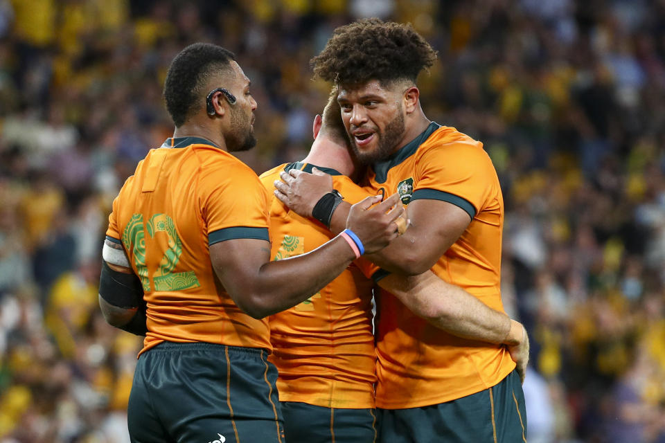 Australia's Samu Kerevi, left, Rob Valetini, right, and Andrew Kellaway celebrate after defeating South Africa in their Rugby Championship test match between the Springboks and the Wallabies in Brisbane, Australia, Saturday, Sept. 18, 2021. (AP Photo/Tertius Pickard)