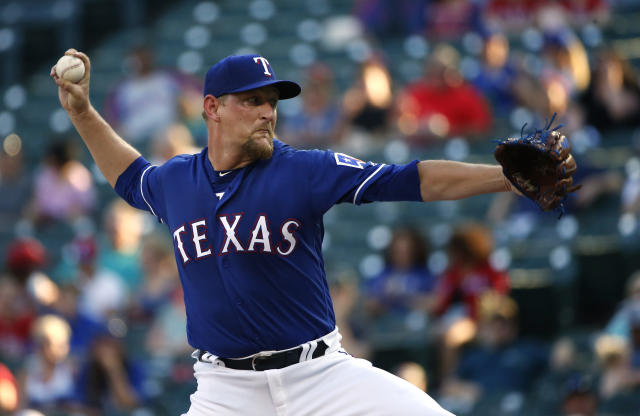 Texas Rangers starting pitcher Austin Bibens-Dirkx (56) delivers against the Kansas City Royals during the first inning of a baseball game Thursday, May 24, 2018, in Arlington, Texas. (AP Photo/Ron Jenkins)