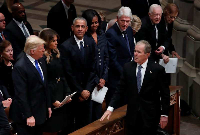 U.S. President George W. Bush walks past U.S. President Donald Trump, first lady Melania Trump, former President Barack Obama, former first lady Michelle Obama, former President Bill Clinton, former first lady Hillary Clinton, former President Jimmy Carter and former first lady Rosalynn Carter as he arrives at the state funeral for his father former U.S. President George H.W. Bush at the Washington National Cathedral in Washington, U.S., December 5, 2018. REUTERS/Kevin Lamarque