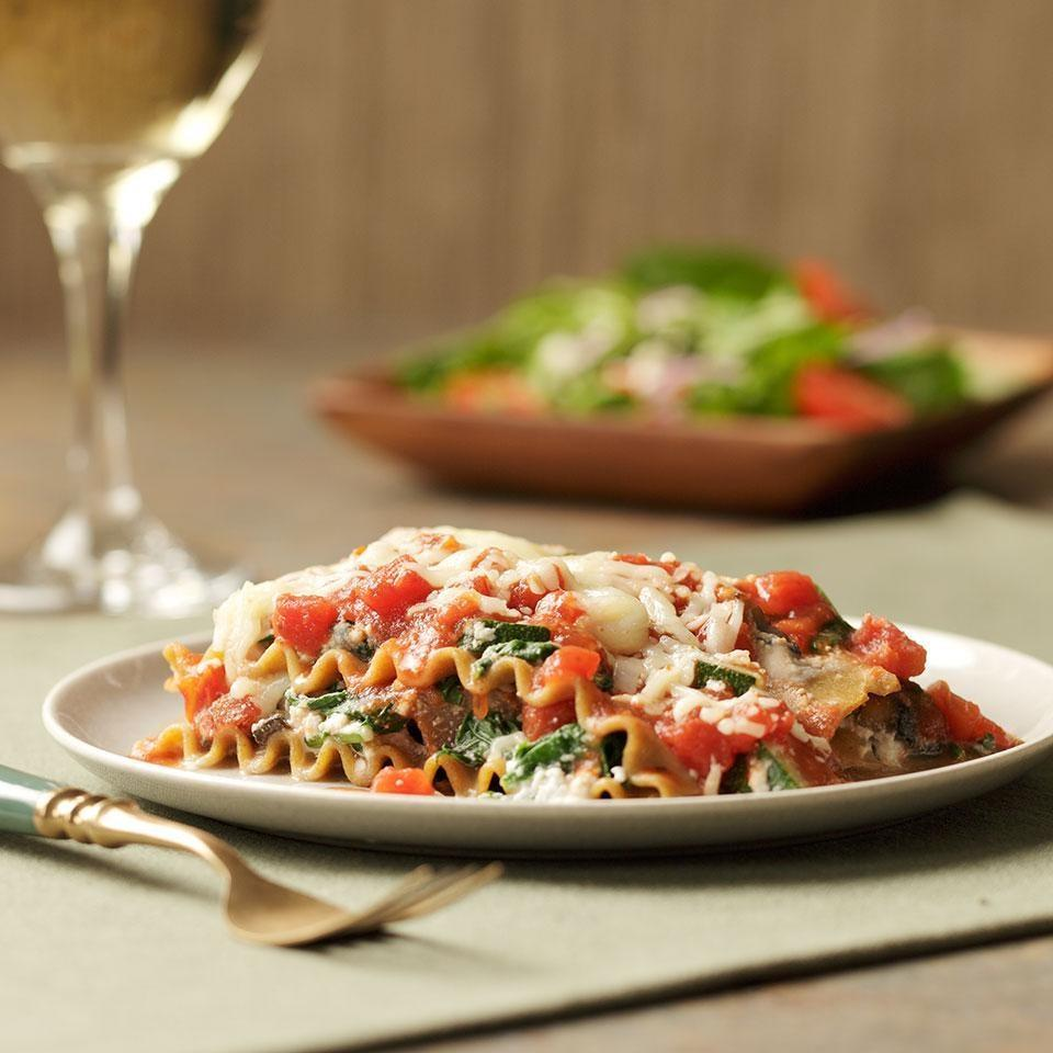 """<p>Sure, the slow cooker's great for stews and soups, but it also happens to make a mean lasagna! In this ingenious slow-cooker recipe, all you have to do is chop your veggies, then layer the ingredients (raw) into the crockpot. Serve with: Garlic bread and a green salad. <a href=""""https://www.eatingwell.com/recipe/252492/slow-cooker-vegetarian-lasagna/"""" rel=""""nofollow noopener"""" target=""""_blank"""" data-ylk=""""slk:View Recipe"""" class=""""link rapid-noclick-resp"""">View Recipe</a></p>"""