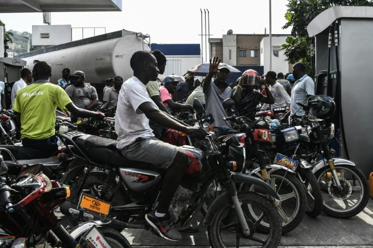 Motorcycle riders in Port-au-Prince, Haiti, wait in line to buy gasoline which is in increasingly short supply