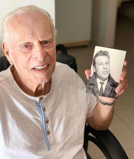 PHOTO: Morris Sana holds a photo of himself when he was younger. (Courtesy Leetal Ofer)