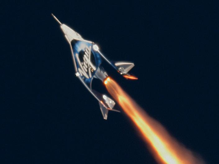 """Virgin Galactic's SpaceShipTwo """"Unity"""" launches toward the edge of space on December 13, 2018."""