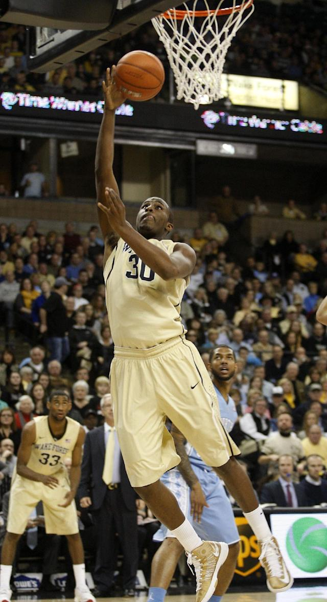 Wake Forest forward Travis McKie scores two of his 16 points to lead his team as they defeat North Carolina 73-67 in an NCAA college basketball game, Sunday, Jan. 5, 2014, in Winston-Salem, N.C. (AP Photo/Nell Redmond)