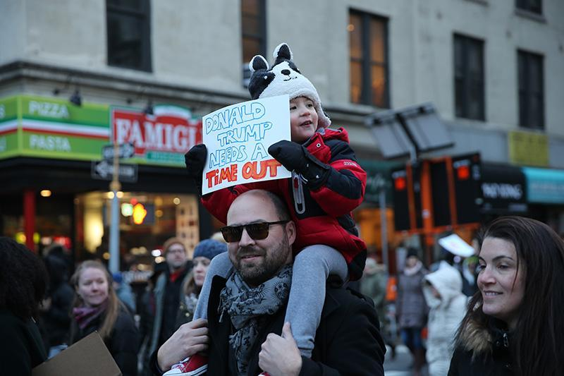 <p>A youngster rides dad's shoulders, holds up a sign during a march in New York, Jan. 29, 2017, protesting President Donald Trump's immigration order. (Gordon Donovan/Yahoo News) </p>