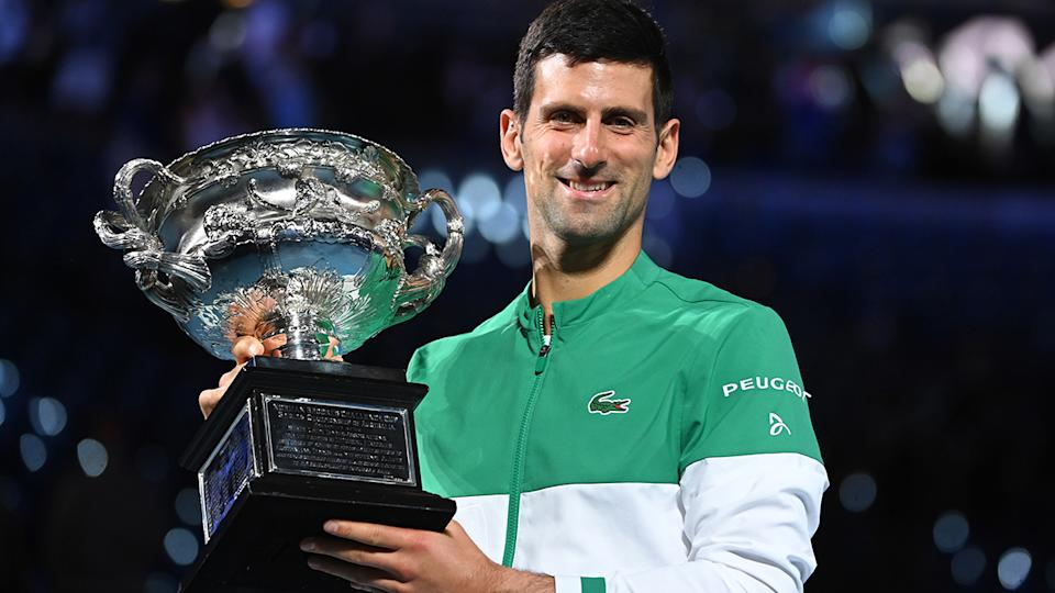 Novak Djokovic, pictured here with the trophy after winning his ninth Australian Open.