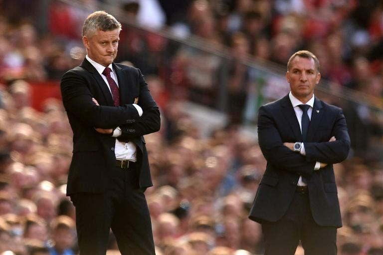 Top-four battle: Manchester United manager Ole Gunnar Solskjaer (left) and Leicester City boss Brendan Rodgers