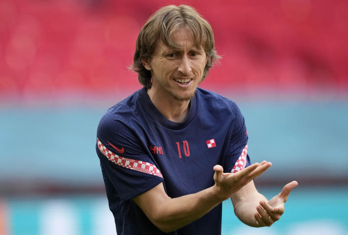 Croatia's Luka Modric gestures during a team training session at Wembley stadium in London, Saturday, June 12, 2021 the day before the Euro 2020 soccer championship group D match between England and Croatia. (AP Photo/Frank Augstein)
