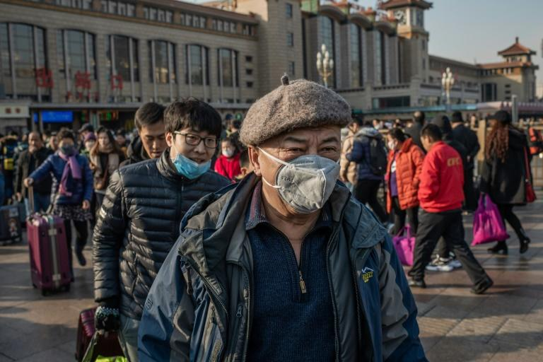 Global fears are mounting about the virus that has killed at least 132 people in China (AFP Photo/NICOLAS ASFOURI)