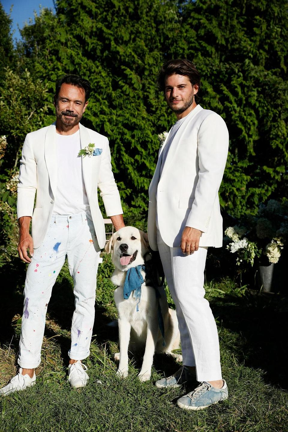"""""""Luca Belle, the 2-year-old Great Pyrenees and Spanish Mastiff mix that brought us together, wearing an indigo collar that carried our Van Cleef & Arpels thin gold wedding bands,"""" Dean says."""