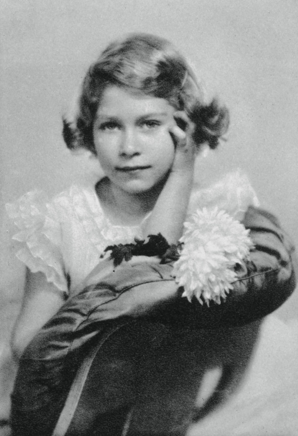 Princess Elizabeth aged nine, 1935, (1937). The future Queen Elizabeth II (1926-). A photograph from the Illustrated London News: Coronation Record Number, (London, 1937). (Photo by The Print Collector/Print Collector/Getty Images)