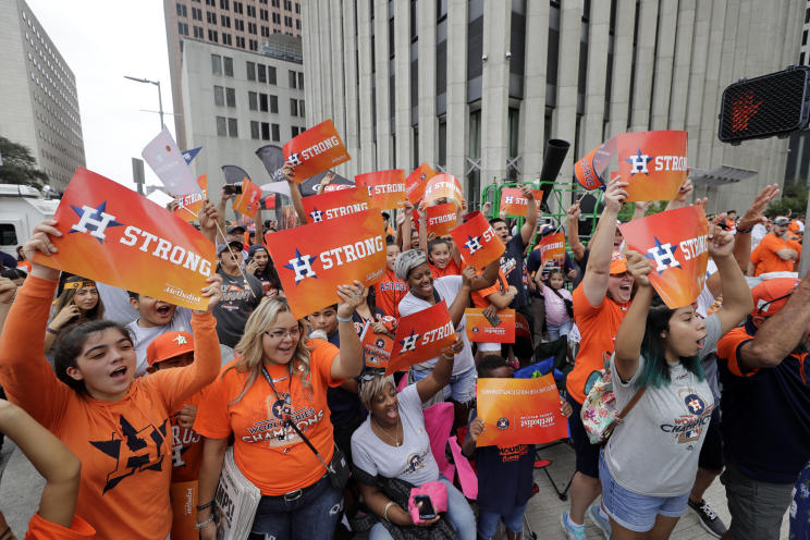 Houston Astros fans celebrate before a parade honoring the World Series baseball champions. (AP)