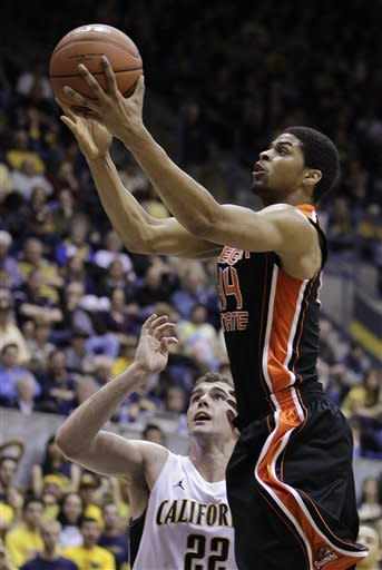 Oregon State's Devon Collier, right, shoots against California's Harper Kamp (22) during the first half of an NCAA college basketball game on Saturday, Feb. 18, 2012, in Berkeley, Calif. (AP Photo/Ben Margot)