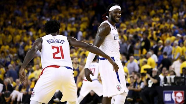 "Clippers teammates Patrick Beverley, left, and Montrezl Harrell celebrate during a playoff game against the Golden State Warriors last season. The two will participate in a video game basketball tournament with other NBA players. <span class=""copyright"">(Ezra Shaw / Getty Images)</span>"