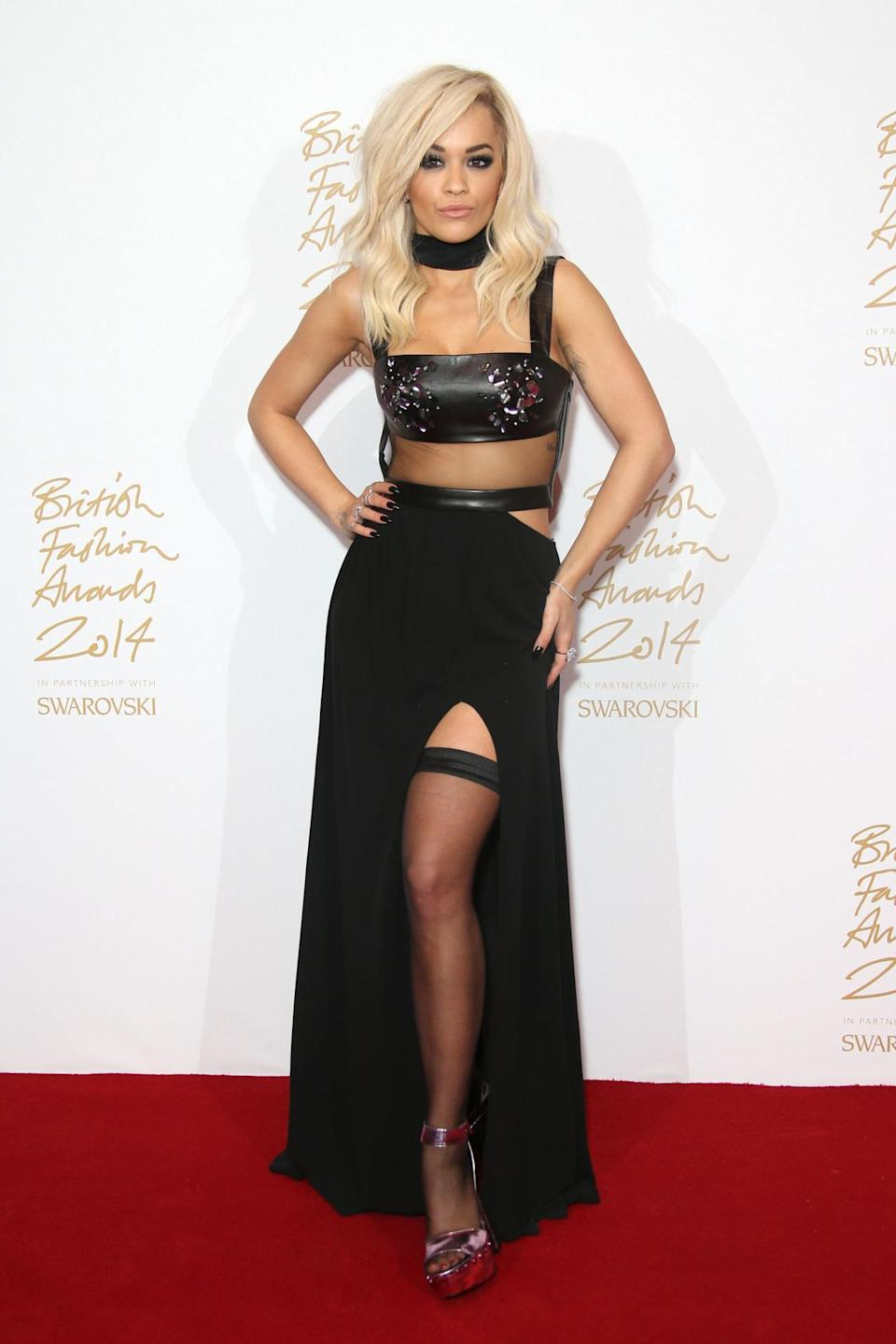 Rita Ora was on hand to present Prism with the Emerging Accessory Designer award — and did so in serious style. Wearing a Tom Ford gown from his most recent runway collection, the look was high class dominatrix with black illusion panels, a black leather bra with silver spikes, and a thigh-high slit to show off thigh-high stockings.