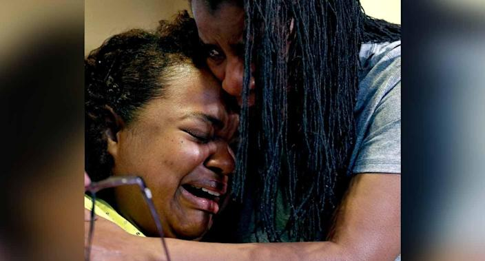Tia Coleman is comforted by her sister Leeta Bigbee after speaking to the media on Saturday. Source: AP via AAP