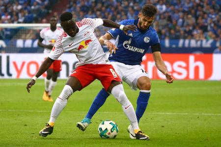 Schalke's Daniel Caligiuri in action with RB Leipzig's Naby Keita.    REUTERS/Wolfgang Rattay