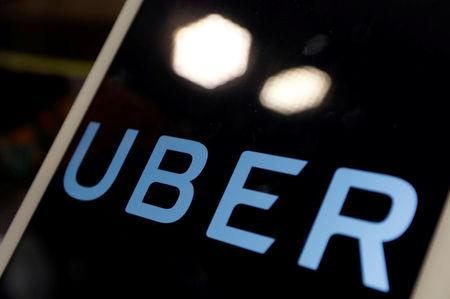 The logo of Uber is seen on an iPad, during a news conference to announce Uber resumes ride-hailing service, in Taipei
