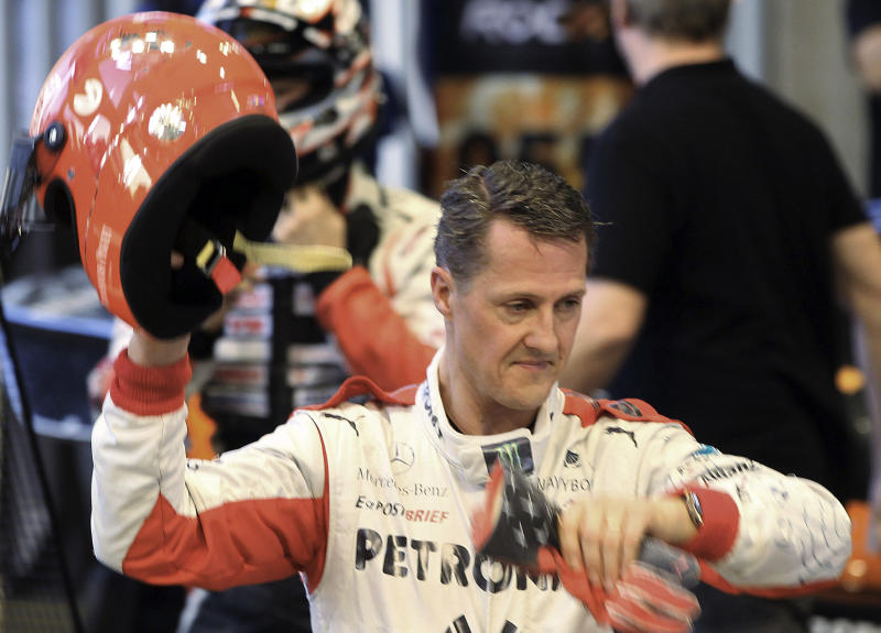 "FILE - This is a Sunday, Dec. 16, 2012. file photo of Michael Schumacher of Germany as he holds a helmet after a test drive prior to the Race Of Champions at Rajamangala national stadium in Bangkok, Thailand. Doctors in Grenoble France treating former seven-time World Formula One champion Michael Schumacher refused Monday Dec. 30, 2013 to predict the outcome for the former Formula One driver, saying they were taking his very critical head injury ""hour by hour"" following his ski accident in Meribel, France on Sunday. (AP Photo/Apichart Weerawong, File)"