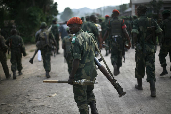 FARDC Congolese government troops patrol near Minova, some 40 mms south-west of Goma, Thursday Nov. 29, 2012. M23 Rebels, who last week seized one of the most important cities in eastern Congo and advanced beyond, said Thursday that they had pulled back several miles (kilometers ) to the town of Sake and were on track to leave the key city of Goma by Friday, in accordance with a deadline imposed by the international community. Governement troops were massing in Minova.(AP Photo/Jerome Delay)