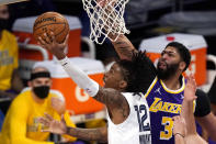 Memphis Grizzlies guard Ja Morant, left, shoots as Los Angeles Lakers forward Anthony Davis defends during the first half of an NBA basketball game Friday, Feb. 12, 2021, in Los Angeles. (AP Photo/Mark J. Terrill)