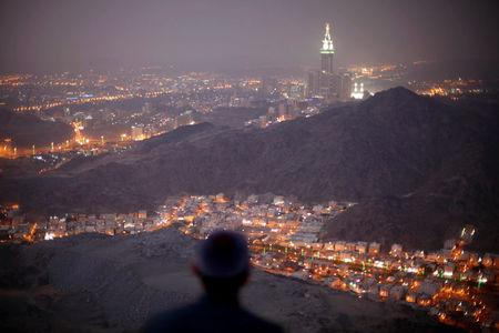 FILE PHOTO: A Muslim pilgrim prays atop Mount Thor in the holy city of Mecca ahead of the annual haj pilgrimage October 11, 2013. REUTERS/Ibraheem Abu Mustafa/File Photo