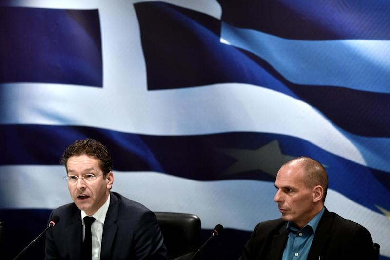 Eurogroup chairman Jeroen Dijsselbloem (L) and Greek Finance Minister Yanis Varoufakis give a press conference after their meeting in Athens on January 30, 2015 (AFP Photo/Aris Messinis)