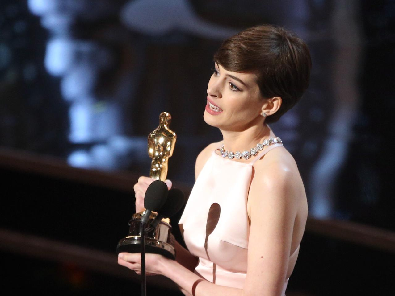 HOLLYWOOD, CA - FEBRUARY 24: Actress Anne Hathaway accepts an award onstage during the Oscars held at the Dolby Theatre on February 24, 2013 in Hollywood, California. (Photo by Mark Davis/WireImage)