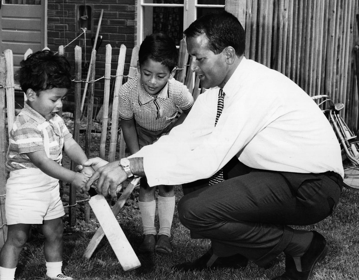 circa 1968:  Worcestershire cricketer Basil D'Oliveira plays with his children. He left South Africa because of racism, but he was likely to lose his place on England's test team because, as they were playing South Africa, they couldn't have non-whites on the team.  (Photo by John Pratt/Keystone/Getty Images)