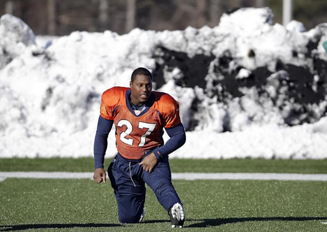 Denver Broncos running back Knowshon Moreno (27) stretches in front of a pile of snow during practice Wednesday, Jan. 29, 2014, in Florham Park, N.J. The Broncos are scheduled to play the Seattle Seahawks in the NFL Super Bowl XLVIII football game Sunday, Feb. 2, in East Rutherford, N.J. (AP Photo/Mark Humphrey)