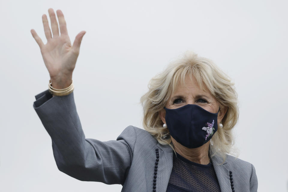 First lady Jill Biden arrives to board an aircraft as she departs Washington on travel to Salt Lake City, Utah, Wednesday, May 5, 2021, at Andrews Air Force Base, Md. (Carlos Barria/Pool via AP)