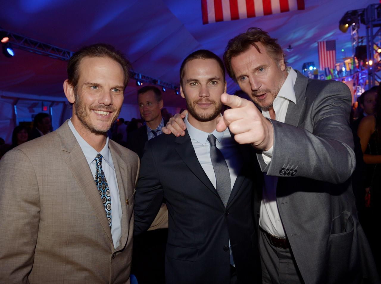 "LOS ANGELES, CA - MAY 10:  (L-R) Producer/director Peter Berg, actors Taylor Kitsch and Liam Neeson pose at the after party for the premiere of Universal Pictures' ""Battleship"" at L.A. Live on May 10, 2012 in Los Angeles, California.  (Photo by Kevin Winter/Getty Images)"