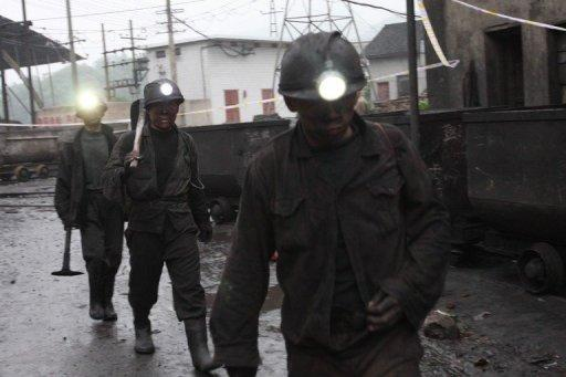 Chinese workers prepare to rescue trapped colleagues from the Shuanfeng coal mine in 2011
