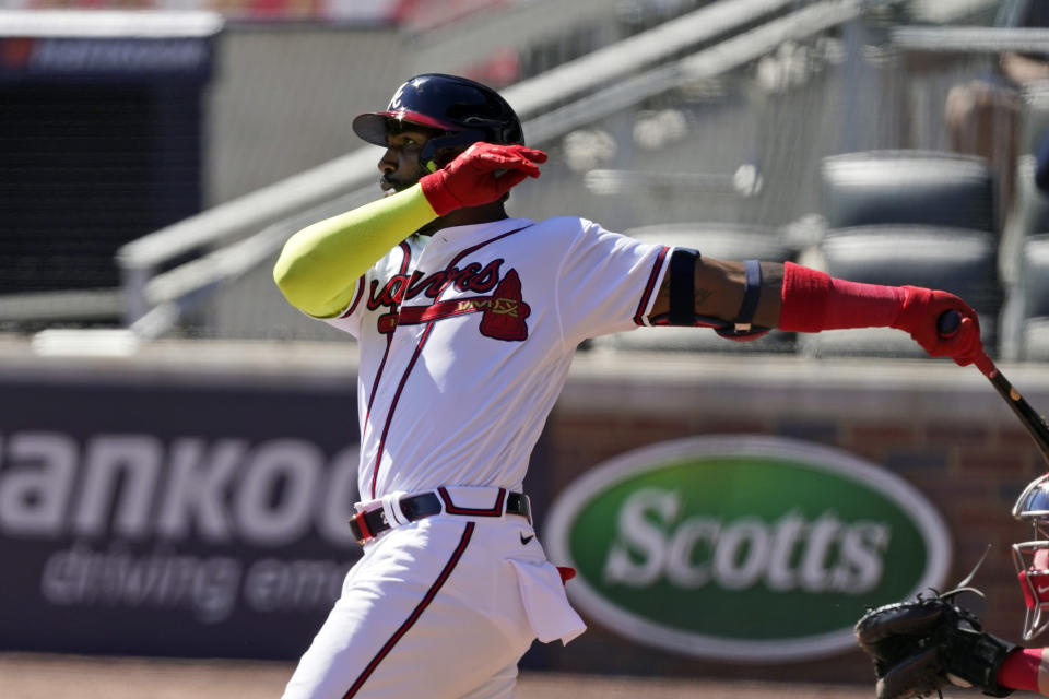 Atlanta Braves' Marcell Ozuna (20) hits a two-run home run during the eighth inning against the Cincinnati Reds in Game 2 of a National League wild-card baseball series, Thursday, Oct. 1, 2020, in Atlanta. (AP Photo/John Bazemore)