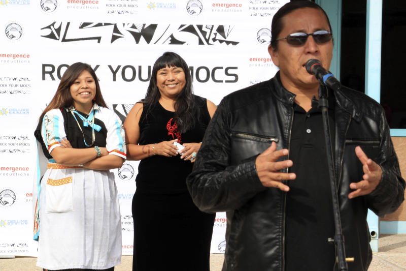 """Jessica """"Jaylyn"""" Atsye of Laguna Pueblo, left, and Melissa Sanchez listen as Emmett Shkeme Garcia talks about the importance of the """"Rock Your Mocs"""" campaign during a celebration at the Indian Pueblo Cultural Center in Albuquerque, N.M., on Friday, Nov. 15, 2013. The social media campaign started by Atsye has gone global with Native American and indigenous people from as far away as New Zealand participating. (AP Photo/Susan Montoya Bryan)"""