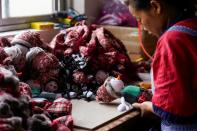 An employee makes Christmas products at Fuye toy factory following the coronavirus disease (COVID-19) outbreak in Yiwu