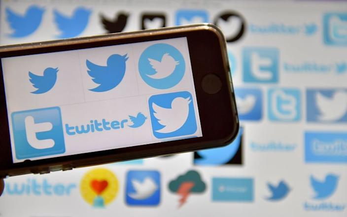 "Twitter users could try to foil Russia's campaign to divide the country before the November election by avoiding posting content that they have not fact-checked. <span class=""copyright"">(Loic Venance / AFP/Getty Images)</span>"