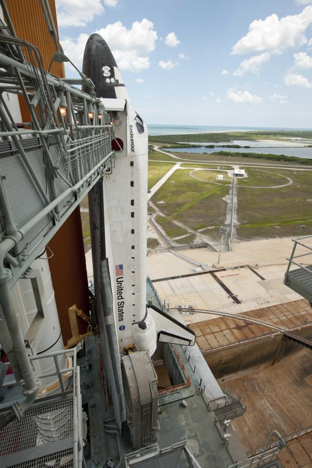 In this photo provided by NASA, the space shuttle Endeavour is seen on launch pad 39a after the rollback of the Rotating Service Structure (RSS), Sunday, May 15, 2011, at Kennedy Space Center in Cape Canaveral, Fla. During the mission, Endeavour and the STS-134 crew will deliver the Alpha Magnetic Spectrometer (AMS) and spare parts including two S-band communications antennas, a high-pressure gas tank and additional spare parts for Dextre. Launch is targeted for Monday, May 16 at 8:56 a.m. EDT.